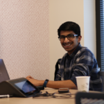 advisor working on laptop learning how to get started with AI
